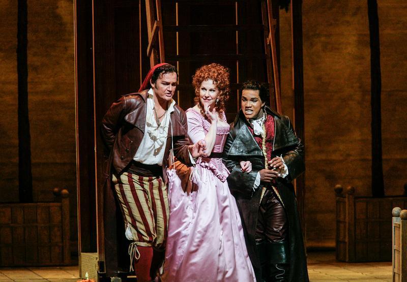 """Russell Braun as Figaro, Joyce DiDonato as Rosina, and Lawrence Brownlee as Count Almaviva in Rossini's """"Il Barbiere di Siviglia."""""""