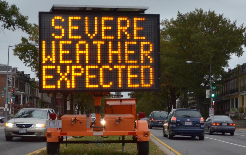 A road sign warns drivers of weather conditions in downtown Washington, DC October 28, 2012 ahead of Hurricane Sandy's landfall.