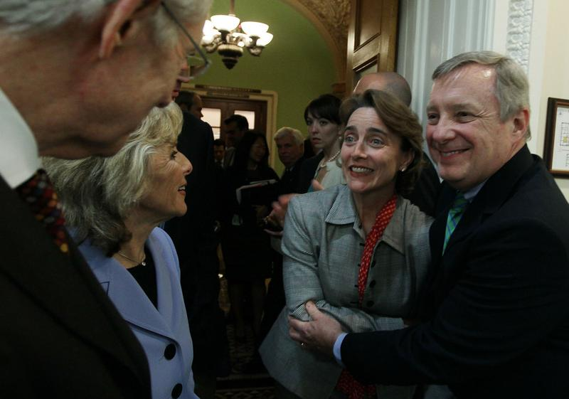 Sen. Richard Durbin (D-IL) hugs Sen. Blanche Lincoln (D-AK)as Sen. Barbara Boxer (D-CA) and Senate Majority Leader Harry Reid (D-NV) stand nearby after voting to pass Wall Street reform, May 20, 2010.