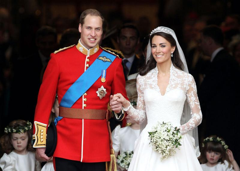 Prince William, Duke of Cambridge and Catherine, Duchess of Cambridge smile following their marriage at Westminster Abbey.