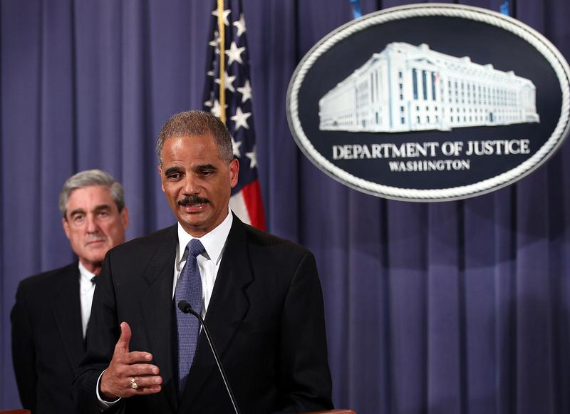 Attorney General Eric Holder (R) and FBI Director Robert Mueller (L) announce a plot was foiled involving men allegedly linked to the Iranian government to kill the Saudi ambassador to the U.S.