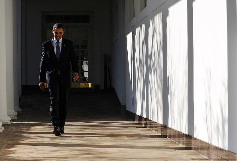 US President Barack Obama walks along the colonnade at the White House in Washington, DC, on January 24, 2012.