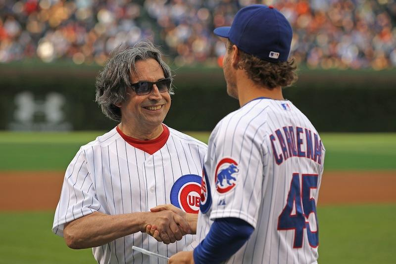 Conductor Riccardo Muti shakes hands with Adrian Cardenas of the Chicago Cubs after throwing out a first pitch at Wrigley Field