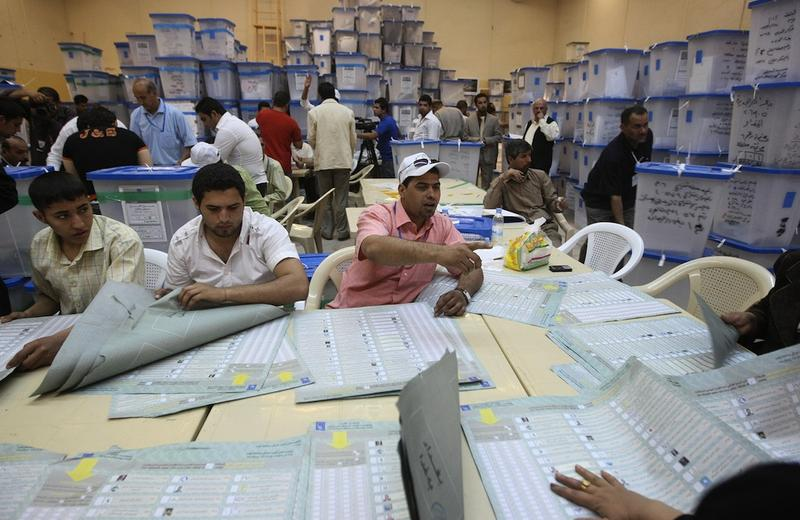 Iraqi electoral officials count votes at the Independent High Electoral Commission headquarters in Baghdad on March 11, 2010, following Iraq's second general elections since the US-led invasion.