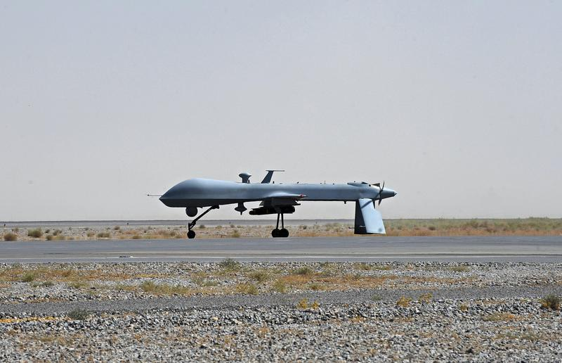A US Predator unmanned drone armed with a missile stands on the tarmac of Kandahar military airport on June 13, 2010.