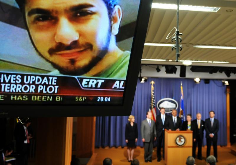 An image of terror suspect Faisal Shahzad is seen on a tv screen as officials old a briefing regarding the investigation into the Times Square attempted bombing, in Washington, D.C.