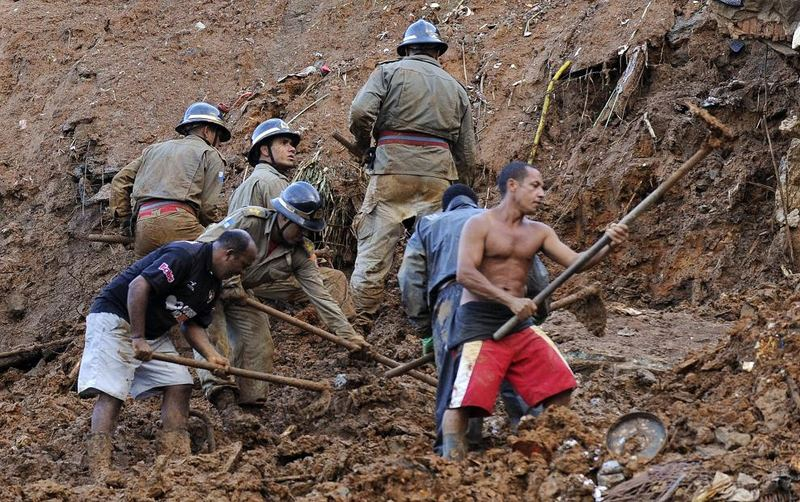 Rescue workers search for victims following a mudslide April 7, 2010