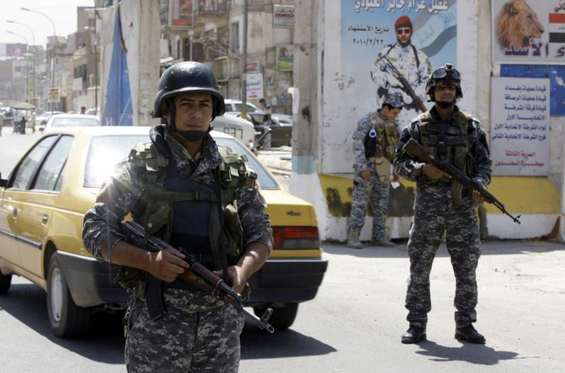 Iraqi soldiers man a checkpoint in Baghdad on August 19, 2010 after the last US combat brigade pulled out of Iraq.