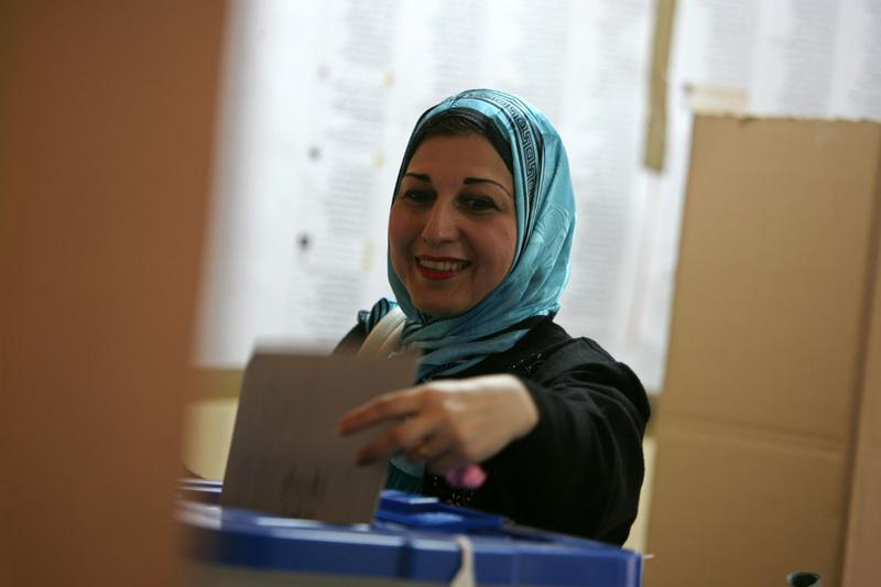 An Iraqi woman casts her ballot for the country's parliamentary elections March 7, 2010 at a polling station in Baghdad, Iraq.