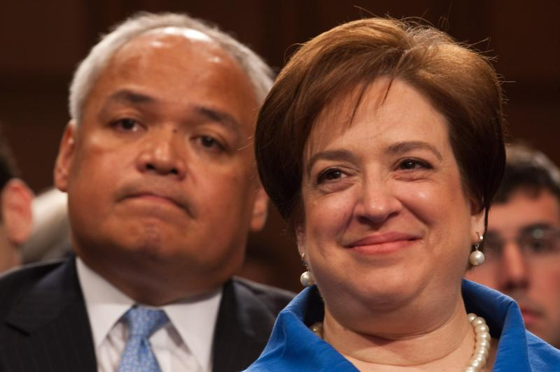 Elena Kagan smiles as she sits in front of Thurgood Marshall, Jr., the son of late Supreme Court Justice Thurgood Marshall, as she appears before the Senate Judiciary Committee yesterday.