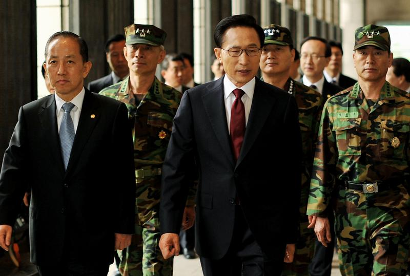 South Korean President Lee Myung-bak walks with defense minister Kim Tae-Young for a press conference at the War Memorial on May 24, 2010 in Seoul, South Korea.