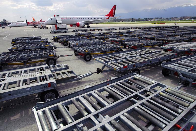 Cargo trolleys are parked on the tarmac at Cointrin Geneva's International Airport, on April 18, 2010 as planes are grounded following the volcanic eruption in Iceland.
