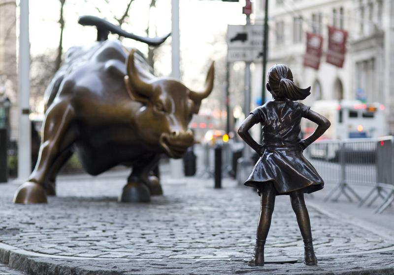 In this March 22, 2017 photo, the Charging Bull and Fearless Girl statues are sit on Lower Broadway in New York.