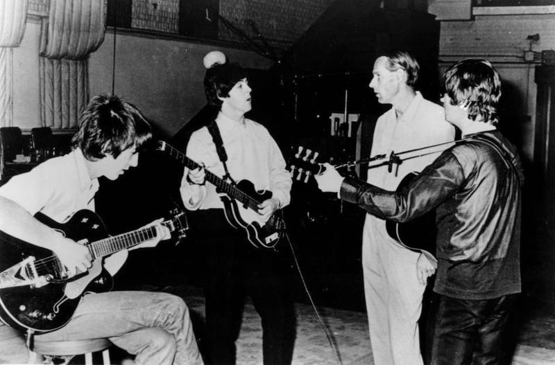 George Harrison, Paul McCartney and John Lennon with George Martin.
