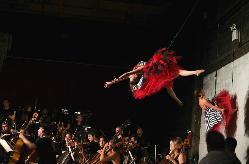 Aerialists perform during the Muse Circus and Experiential Orchestra's performance of 'Symphony Fantastique.'