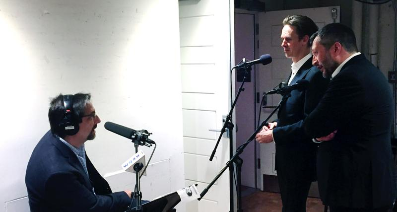 WQXR host Jeff Spurgeon (sitting) backstage at Carnegie Hall with tenor Ian Bostridge and pianist Thomas Adés.