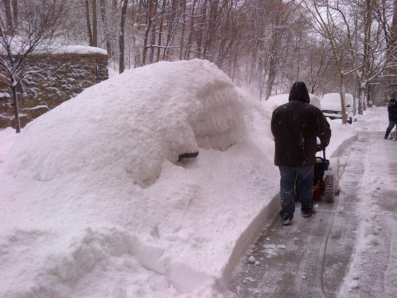 Snowblower buries a car in Inwood