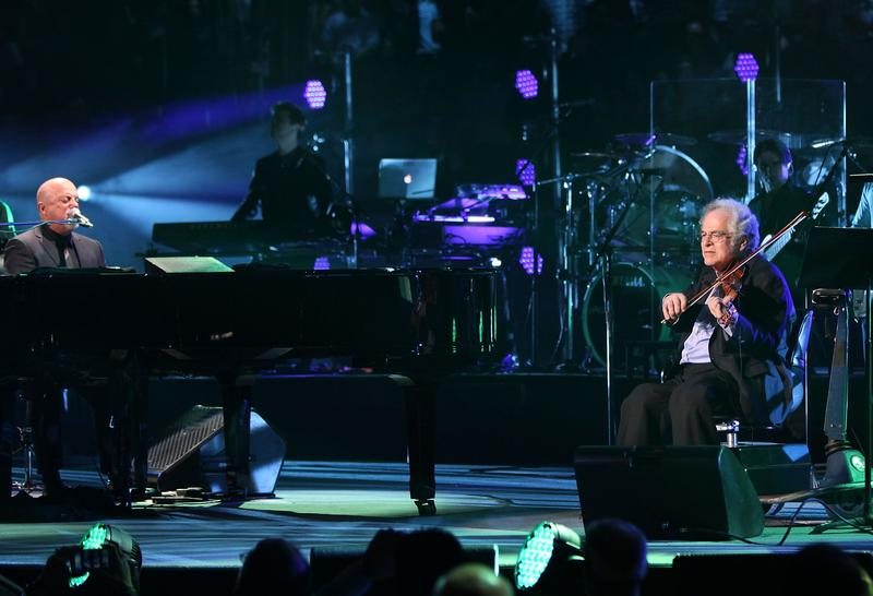 Billy Joel and violinist Itzhak Perlman perform together at Billy Joel's sold out concert at Madison Square Garden on March 9, 2015.