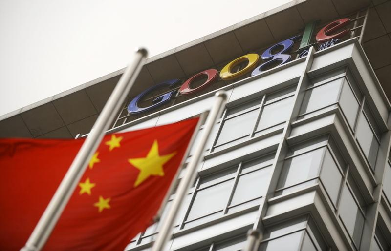 A Chinese flag flies next to the Google company logo outside the Google China headquarters in Beijing on March 22, 2010.