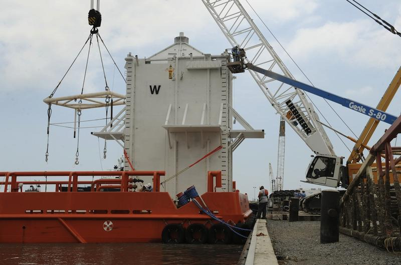 The Pollution Control Dome is lifted onboard an oil workboat in Port Fourchon, as it makes it way to cap the source of the oil slick from the BP Deepwater Horizon platform disaster in Louisiana.