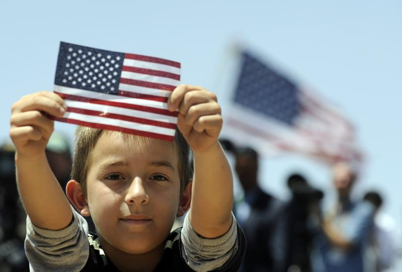A boys shows a US flag as President Barack Obama speaks on immigration at the Chamizal National Memorial on May 10, 2011 in El Paso, Texas.