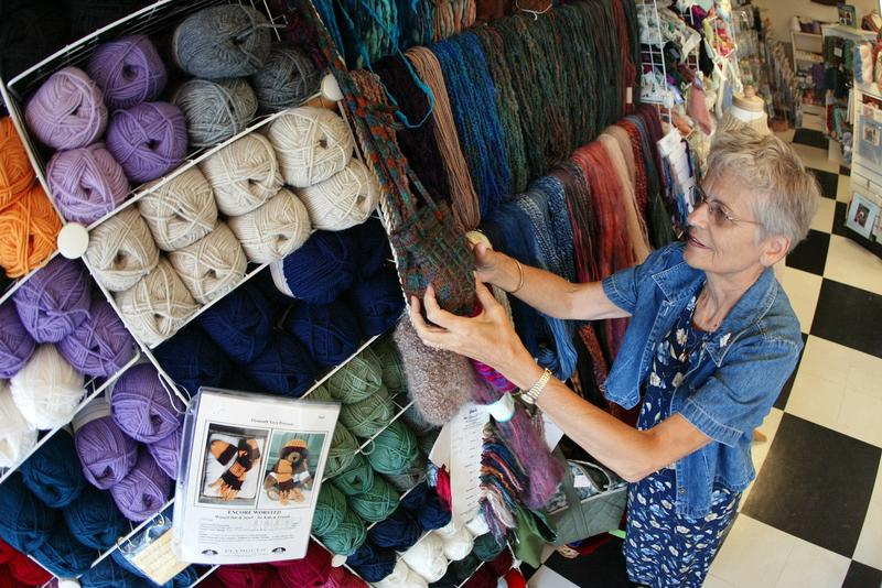 Sixty-eight-year-old Barb Blume arranges yarn at the Mosaic Yarn Studio July 26, 2002 in Des Plaines, Ilinois. Blume is a retired nurse who turned her hobby of knitting into a second career.