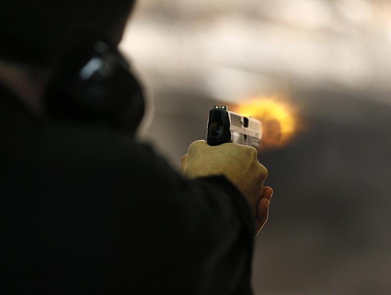 Brett Nielsen fires an Glock handgun at the 'Get Some Guns & Ammo' shooting range on January 15, 2013 in Salt Lake City, Utah.
