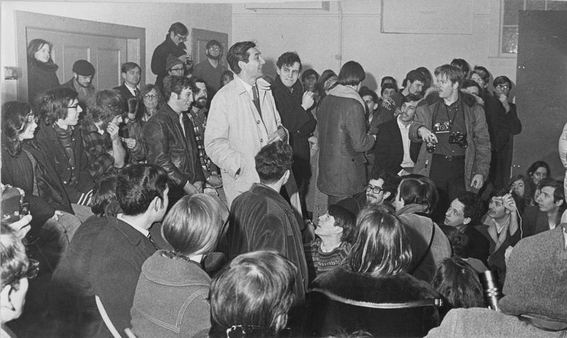 Undated photograph of Howard Zinn, a Boston University Professor with draft protestors at the Arlington Street Church, after marching from the Army Base.