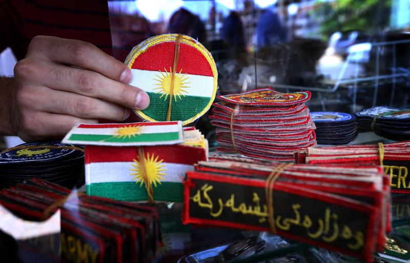 An Iraqi man displays military badges at a shop in Arbil, the capital of the autonomous Kurdish region of northern Iraq.