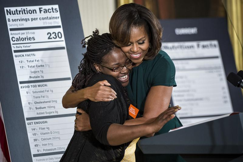 First Lady Michelle Obama hugs Shanese Bryant-Melton during an event introducing new nutrition labeling on February 27, 2014 in Washington, DC.