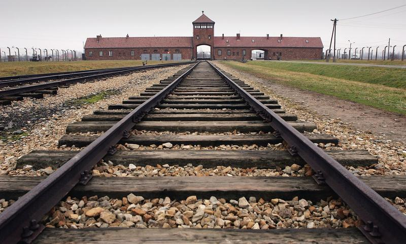 The railway tracks leading to the main gates at Auschwitz II - Birkenau seen December 10, 2004 the camp was built in March 1942 in the village of Brzezinka, Poland.
