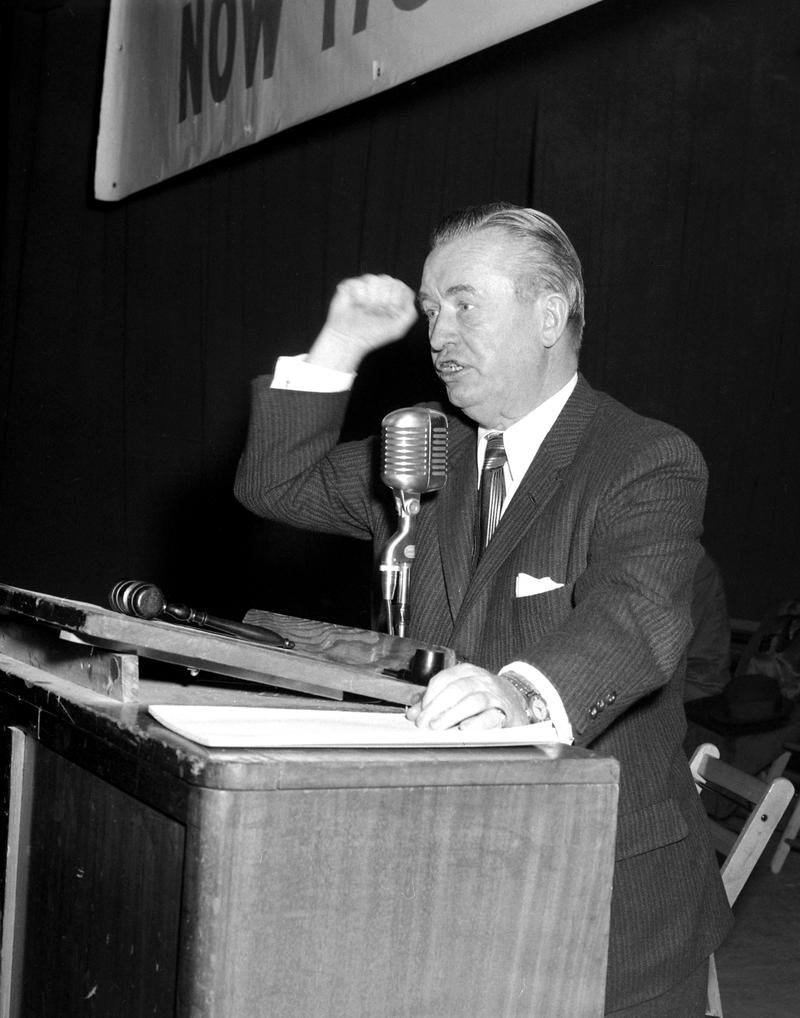 President and Business Manager of the Uniformed Sanitation Men's Association (Local 831) John J. DeLury, as he spoke to members at rally. November 2, 1958.