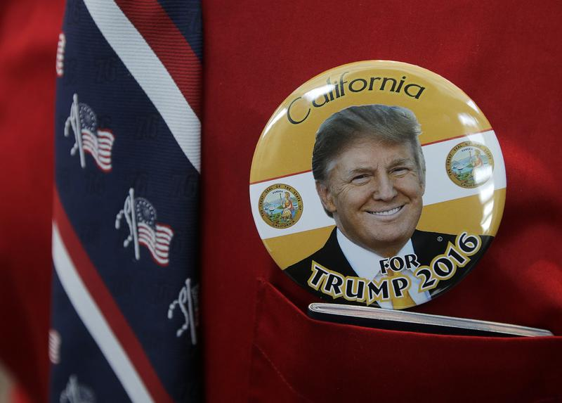 Donald Trump supporter Robert Tally wears a button of Trump before the California Republican Party 2016 Convention in Burlingame, Calif., Friday, April 29, 2016.