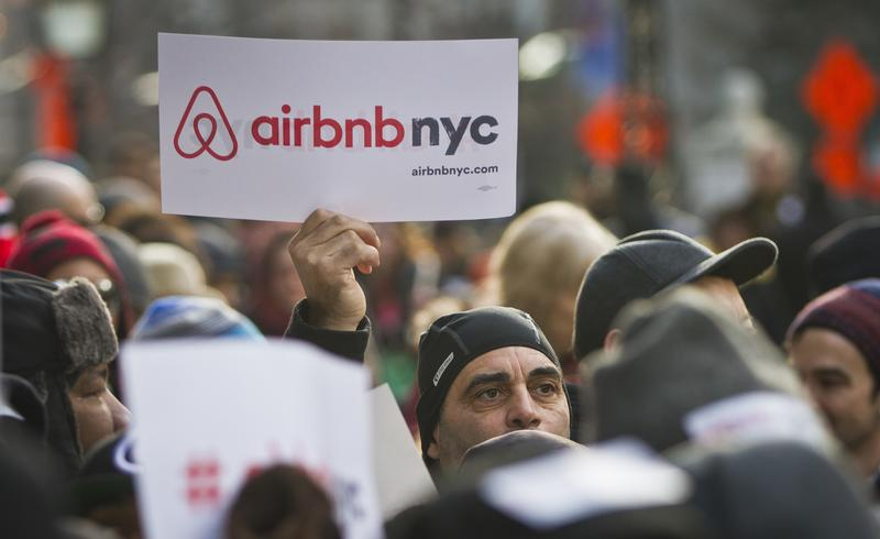 Jan. 20, 2015: Supporters of Airbnb hold a rally outside City Hall in New York.
