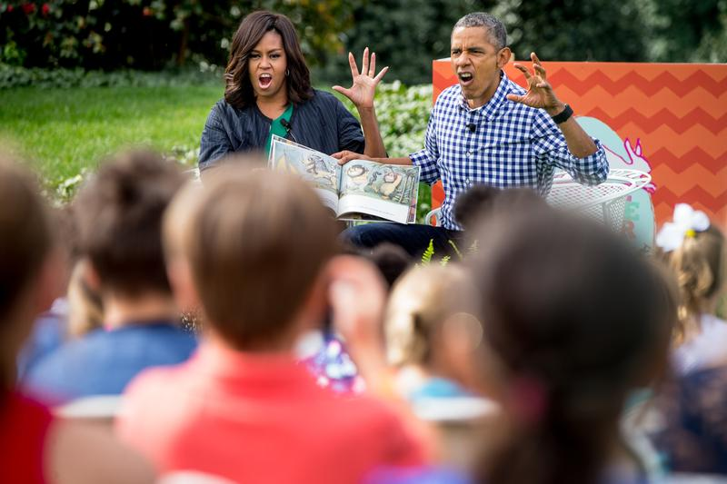 "President Barack Obama and first lady Michelle Obama act out monsters as they read ""Where the Wild Things Are,"" to children at the White House Easter Egg Roll on the South lawn at the White House."