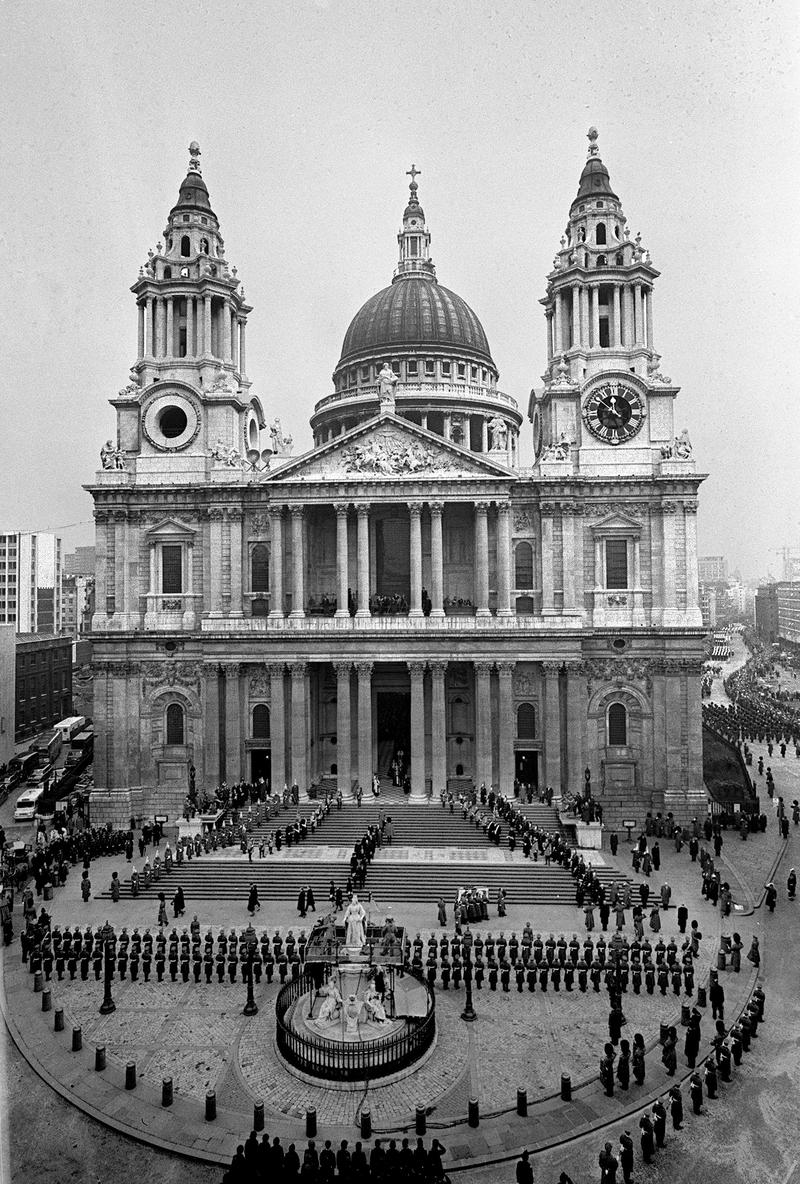 The flag draped coffin of Sir Winston Churchill is borne away on the shoulders of Guards Officers down the steps at the front of St. Paul's Cathedral, Jan. 30, 1965, after the funeral.