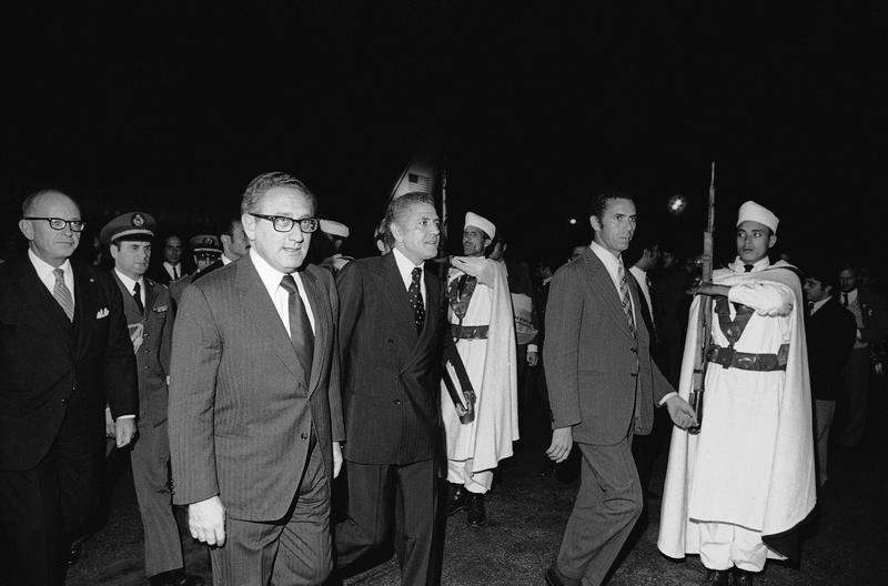 On his first stop on way to the Middle and Far East, U.S. Secretary of State Kissinger is welcomed by Moroccan foreign minister Ahmed Taibi Benhima on Nov. 5, 1973 in Rabat, Morocco.