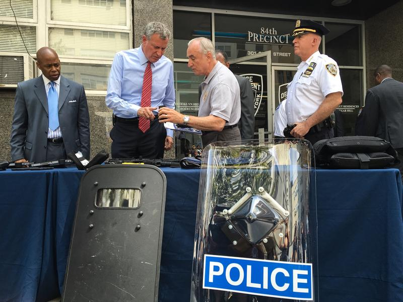 Brooklyn Borough President Eric Adams, Mayor Bill de Blasio, Police Commissioner Bill Bratton and Chief of Department James P. O'Neill unveil new police equipment.