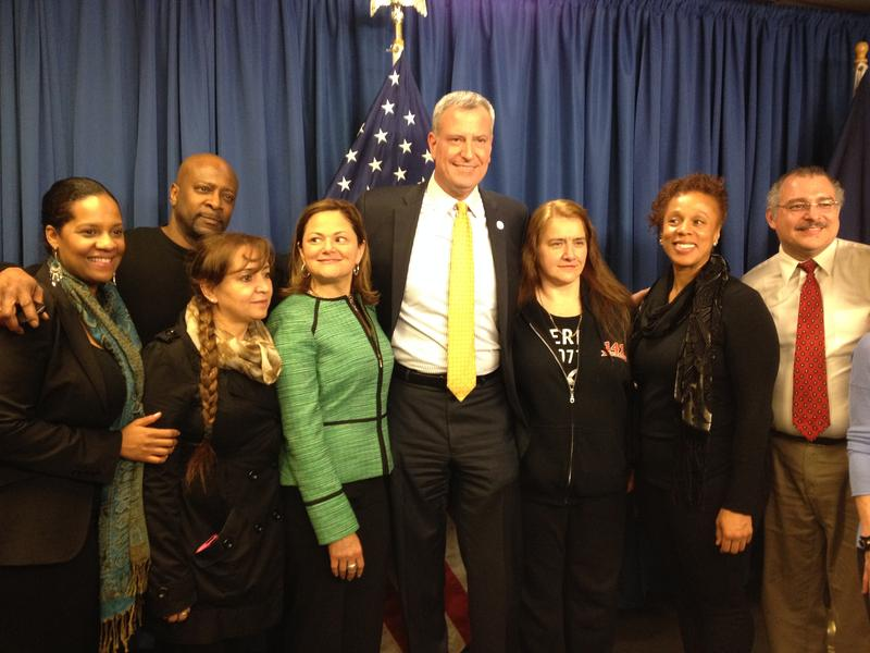 Mayor poses with allies after trumpeting increased funding for pre-K, after-school, HIV/AIDS and homeless programs.