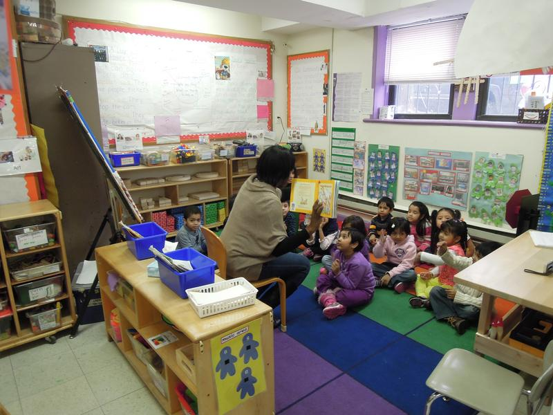 A teacher reads to a pre-kindergarten class at Bright Beginnings Child Care in Jamaica, Queens. The organization submitted a proposal to convert its half-day classes to full-day.