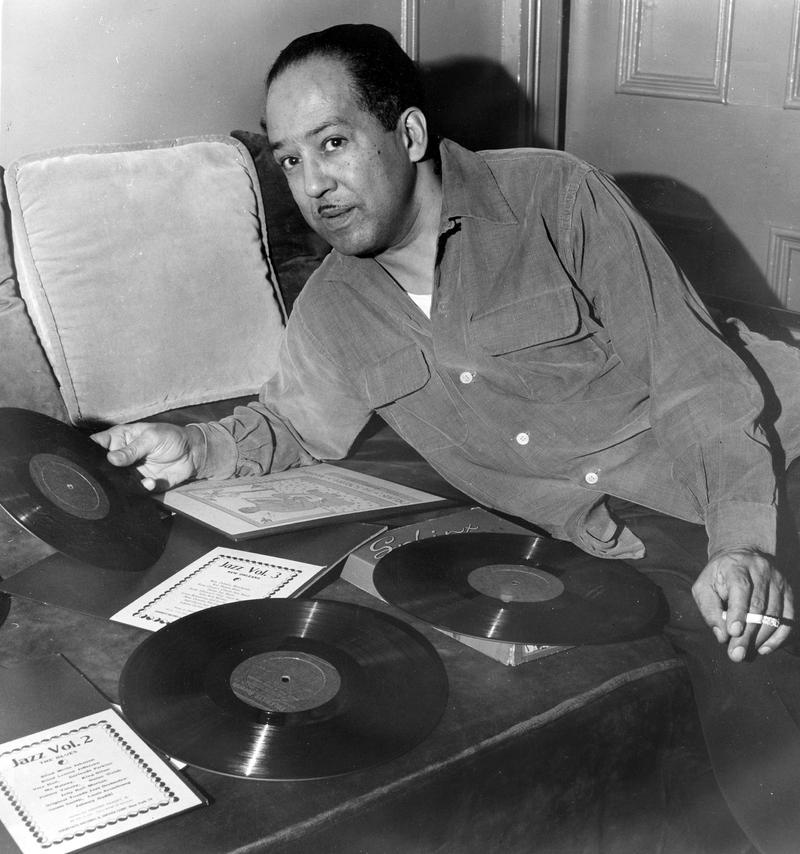 American author Langston Hughes in 1954 with a phonograph record in hand.