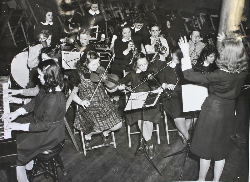 Conducting National Youth Administration Junior Orchestra, January 28, 1941.