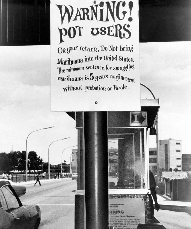 A warning sign states the penalties for bringing marijuana across the border from Mexico into the United States, at Laredo, Texas, May 25, 1970.