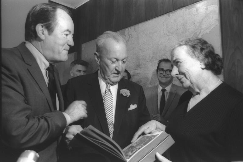 Former U.S. Vice-Pres. Humphrey, former Conn. Senator William Benton (C), presenting P.M. Mrs. Golda Meir with an illustrated Passover Hagada, Jerusalem, May 4, 1970.