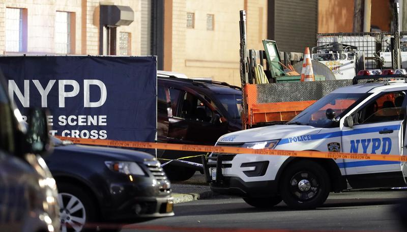 A vehicle, center, involved in a shooting with New York City Police officers is part of a crime scene in the Bronx, Friday, Nov. 4, 2016.