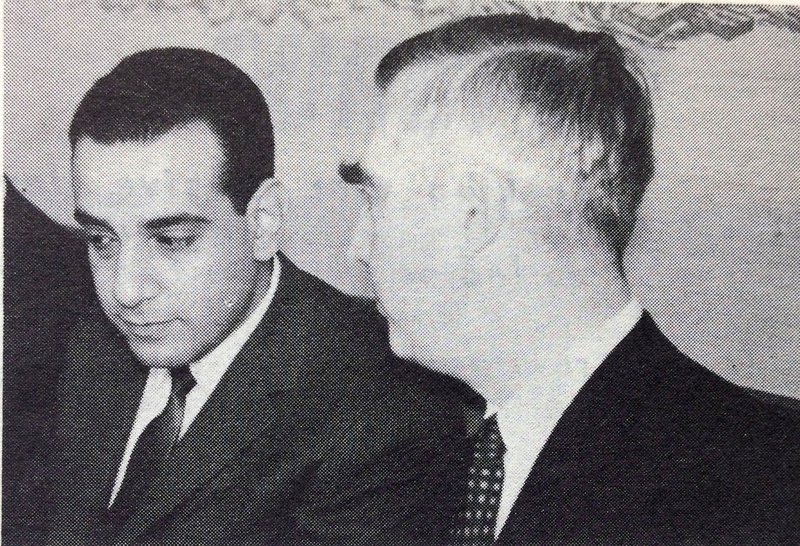 Iraqi Foreign Minister Talib Shabib listening to Overseas Press Club chief Barrett McGurn at a club luncheon.