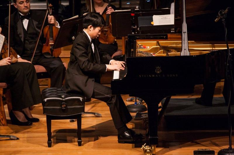Elliot Wuu, first prize winner, with the orchestra during the 2015 Hilton Head International Piano Competition.