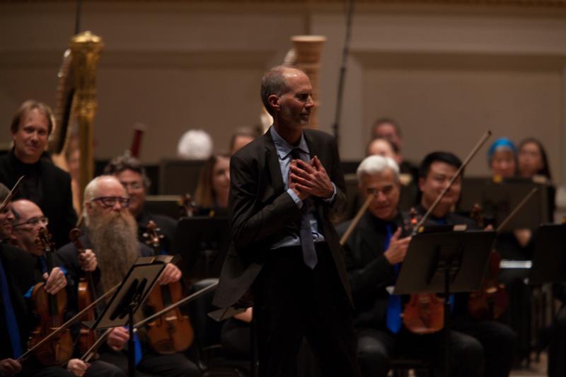 The composer John Luther Adams, whose music is often inspired by the natural world, accepts the enthusiastic applause from the Carnegie Hall audience