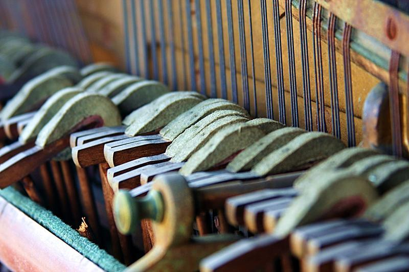 The hammers inside an old upright piano.