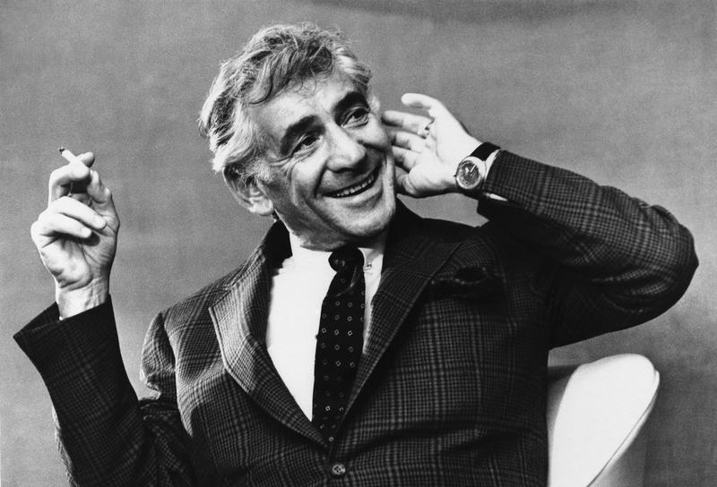 Conductor and composer, Leonard Bernstein smiles as he listens to a question put to him at his press reception at the Savoy Hotel M London, April 4, 1972.